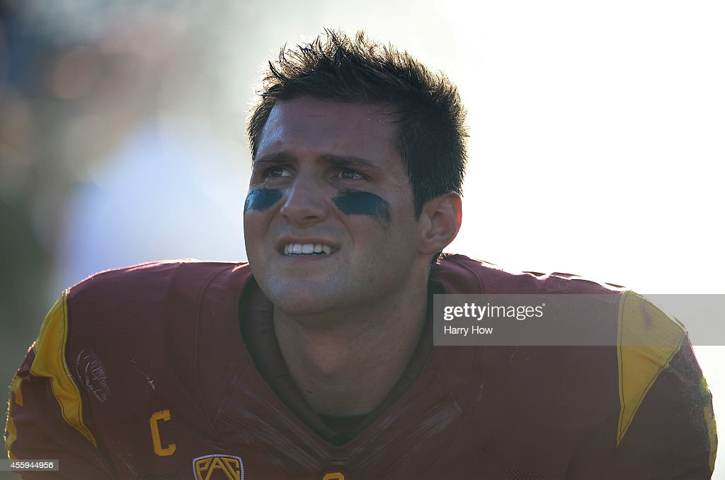 Quarterback Cody Kessler #6 of the USC Trojans watches from the sidelines with his team leading 31-7 over the Fresno State Bulldogs during the second quarter at Los Angeles Memorial Coliseum on August 30, 2014 in Los Angeles, California.
