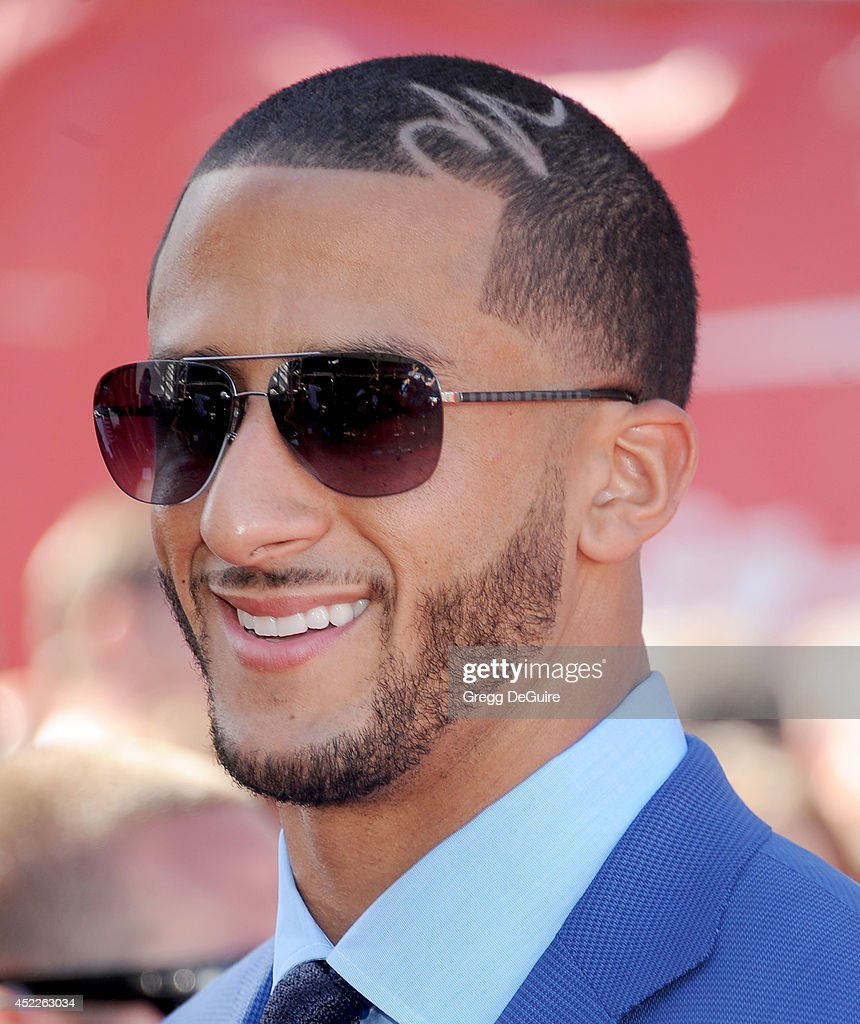 NFL quarterback Colin Kaepernick arrives at the 2014 ESPY Awards at Nokia Theatre L.A. Live on July 16, 2014 in Los Angeles, California.