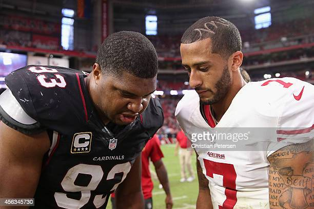 Quarterback Colin Kaepernick of the San Francisco 49ers and defensive end Calais Campbell of the Arizona Cardinals sign their jerseys following the...