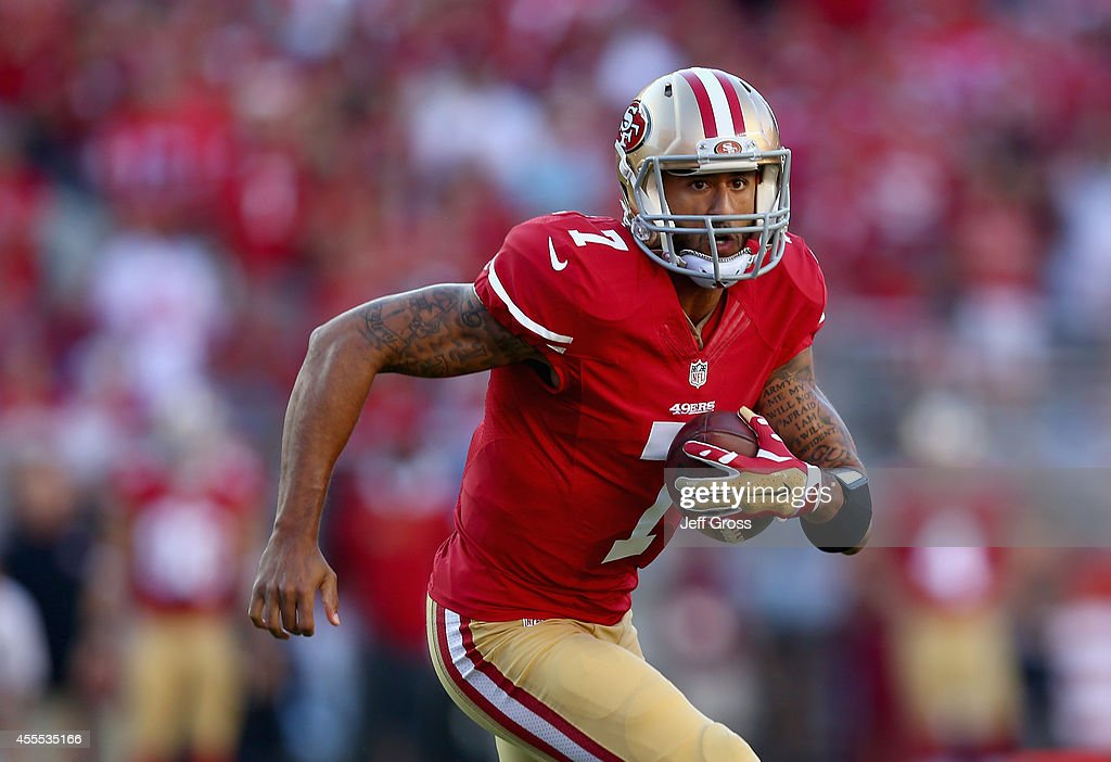 Quarterback <a gi-track='captionPersonalityLinkClicked' href=/galleries/search?phrase=Colin+Kaepernick&family=editorial&specificpeople=5525694 ng-click='$event.stopPropagation()'>Colin Kaepernick</a> #7 of the San Francisco 49ers carries the ball against the Chicago Bears at Levi's Stadium on September 14, 2014 in Santa Clara, California.