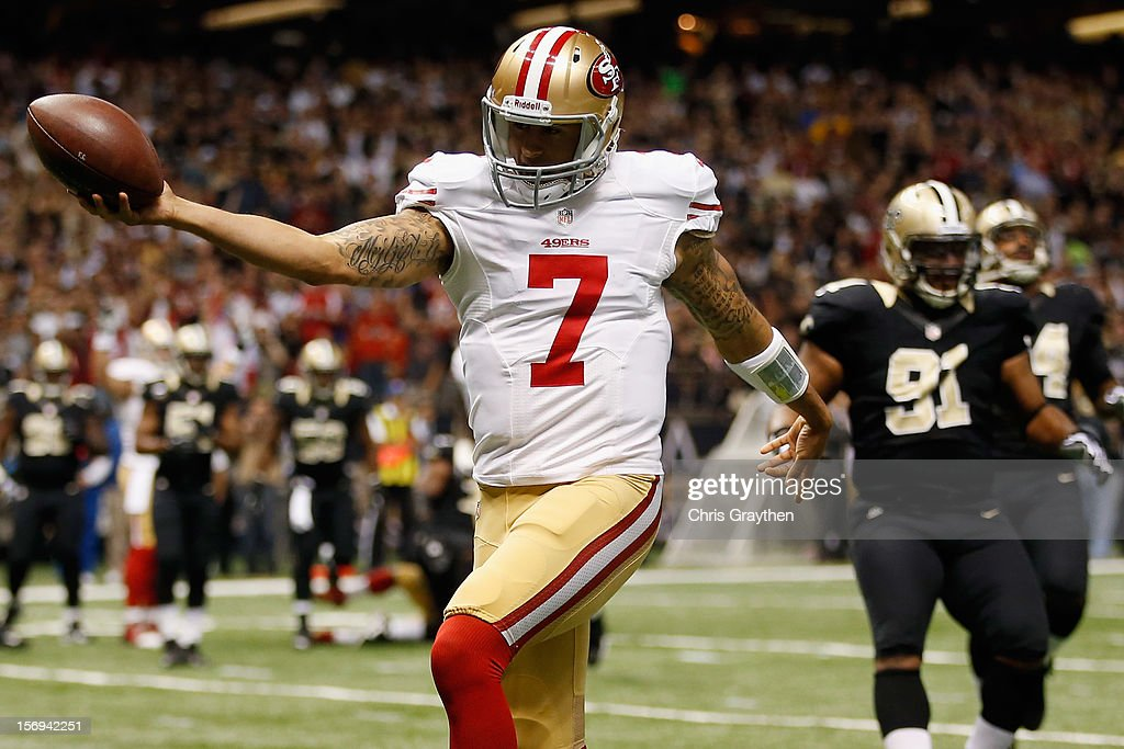 Quarterback <a gi-track='captionPersonalityLinkClicked' href=/galleries/search?phrase=Colin+Kaepernick&family=editorial&specificpeople=5525694 ng-click='$event.stopPropagation()'>Colin Kaepernick</a> #7 of the San Francisco 49ers celebrates after scoring a touchdown against the New Orleans Saints at The Mercedes-Benz Superdome on November 25, 2012 in New Orleans, Louisiana.