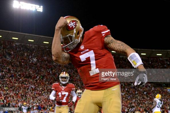 Quarterback Colin Kaepernick of the San Francisco 49ers celebrates after running in a touchdown in the first quarter against the Green Bay Packers...
