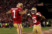 Quarterback Colin Kaepernick of the San Francisco 49ers celebrates with wide receiver Michael Crabtree after running the ball for a touchdown against...