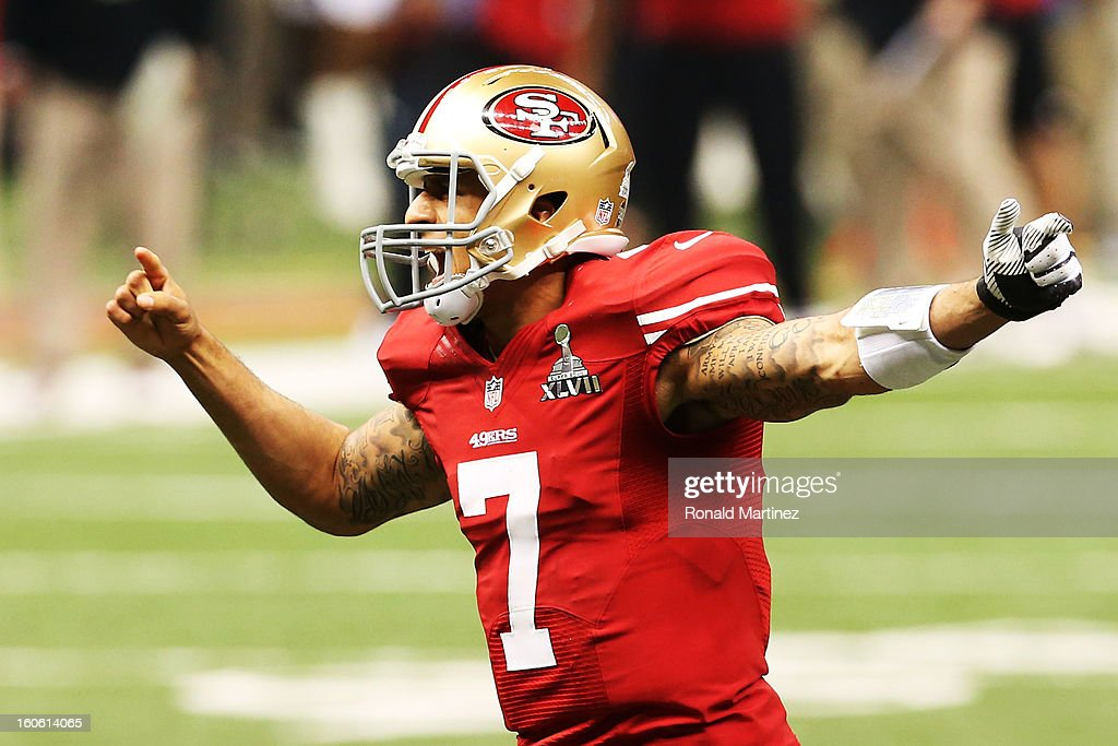 Quarterback Colin Kaepernick #7 of the San Francisco 49ers directs his teammates in the first quarter before a snap against the Baltimore Ravens during Super Bowl XLVII at the Mercedes-Benz Superdome on February 3, 2013 in New Orleans, Louisiana.