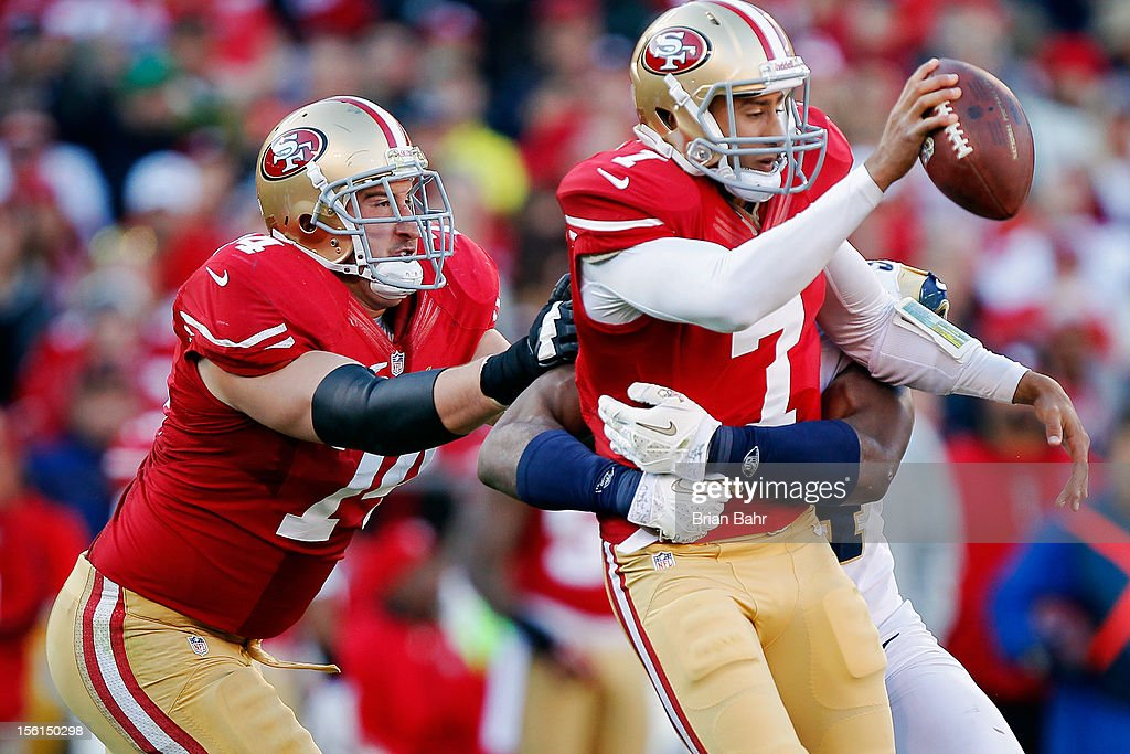 Quarterback <a gi-track='captionPersonalityLinkClicked' href=/galleries/search?phrase=Colin+Kaepernick&family=editorial&specificpeople=5525694 ng-click='$event.stopPropagation()'>Colin Kaepernick</a> #7 of the San Francisco 49ers gets caught by Robert Quinn #94 of the St. Louis Rams in the fourth quarter on November 11, 2012 at Candlestick Park in San Francisco, California. The teams tied 24-24 in overtime.