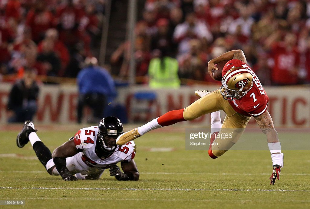 Quarterback <a gi-track='captionPersonalityLinkClicked' href=/galleries/search?phrase=Colin+Kaepernick&family=editorial&specificpeople=5525694 ng-click='$event.stopPropagation()'>Colin Kaepernick</a> #7 of the San Francisco 49ers goes down after being tackled by linebacker Stephen Nicholas #54 of the Atlanta Falcons during a game at Candlestick Park on December 23, 2013 in San Francisco, California.