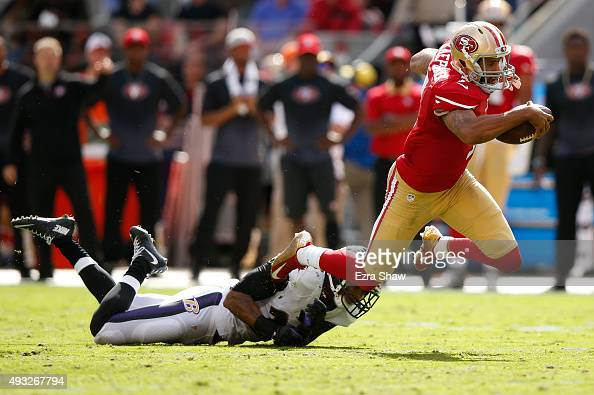 Quarterback Colin Kaepernick of the San Francisco 49ers is tackled by cornerback Jimmy Smith of the Baltimore Ravens during their NFL game at Levi's...