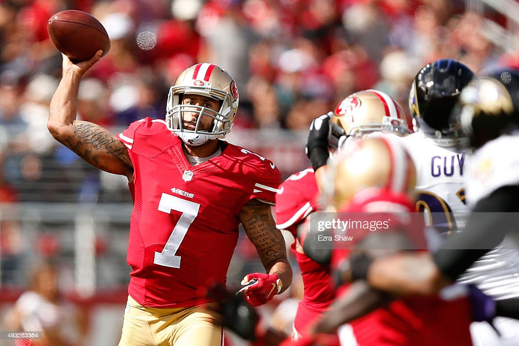 Quarterback Colin Kaepernick of the San Francisco 49ers looks to pass the ball against the Baltimore Ravens in the first quarter of their NFL game at...