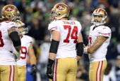 Quarterback Colin Kaepernick of the San Francisco 49ers looks to the sideline during the 2014 NFC Championship against the Seattle Seahawks at...