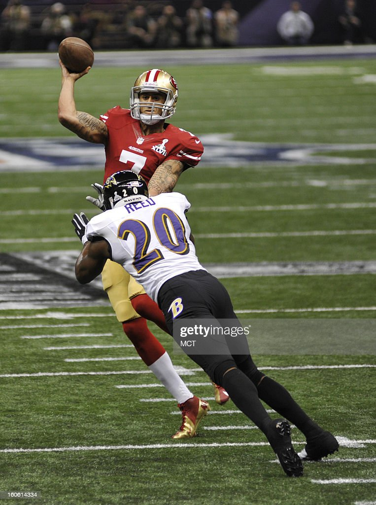 Quarterback Colin Kaepernick (7) of the San Francisco 49ers makes a pass over Ed Reed (20) of the Baltimore Ravens in the first half of Super Bowl XLVII at the Mercedes-Benz Superdome in New Orleans, Louisiana, Sunday, February 3, 2013.