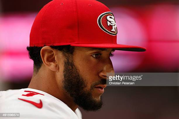 Quarterback Colin Kaepernick of the San Francisco 49ers on the sidelines during the NFL game against the Arizona Cardinals at the University of...