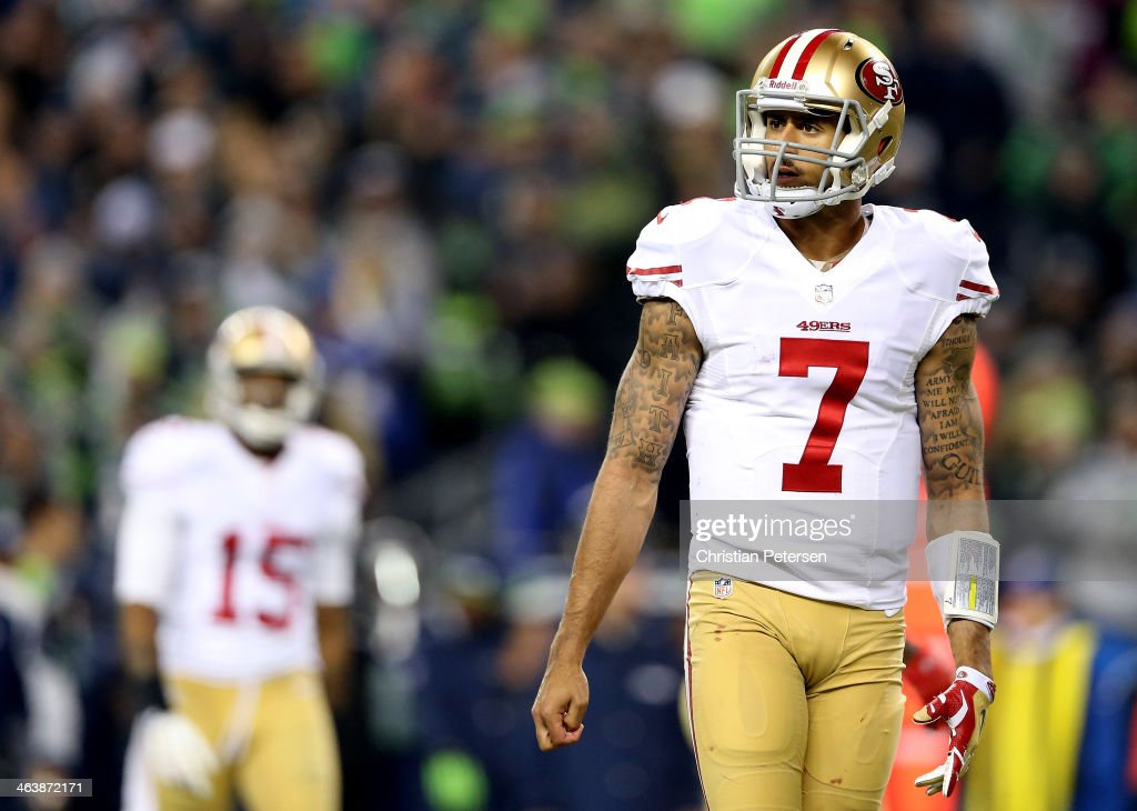 Quarterback Colin Kaepernick #7 of the San Francisco 49ers reacts in the fourth quarter while taking on the Seattle Seahawks during the 2014 NFC Championship at CenturyLink Field on January 19, 2014 in Seattle, Washington.