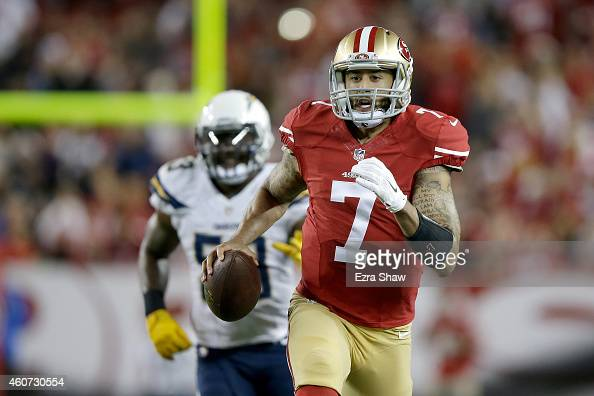 Quarterback Colin Kaepernick of the San Francisco 49ers runs ahead of inside linebacker Kavell Conner of the San Diego Chargers in the first half at...