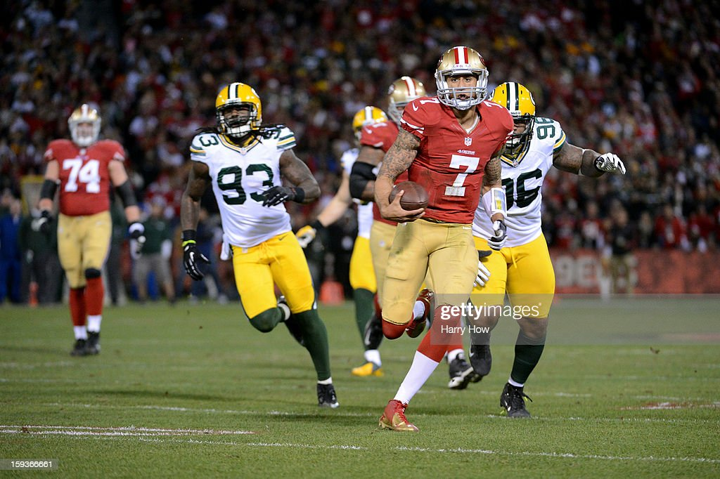 Quarterback Colin Kaepernick #7 of the San Francisco 49ers runs for a touchdown in the first quarter against the Green Bay Packers during the NFC Divisional Playoff Game at Candlestick Park on January 12, 2013 in San Francisco, California.