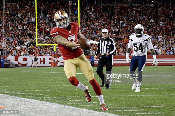 Quarterback Colin Kaepernick of the San Francisco 49ers runs for a first down in the first half against the San Diego Chargers at Levi's Stadium on...