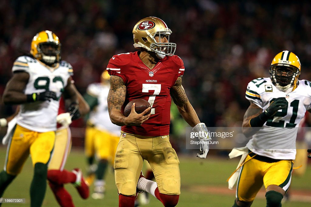 Quarterback <a gi-track='captionPersonalityLinkClicked' href=/galleries/search?phrase=Colin+Kaepernick&family=editorial&specificpeople=5525694 ng-click='$event.stopPropagation()'>Colin Kaepernick</a> #7 of the San Francisco 49ers runs the ball for a touchdown against the Green Bay Packers in the third quarter during the NFC Divisional Playoff Game at Candlestick Park on January 12, 2013 in San Francisco, California.