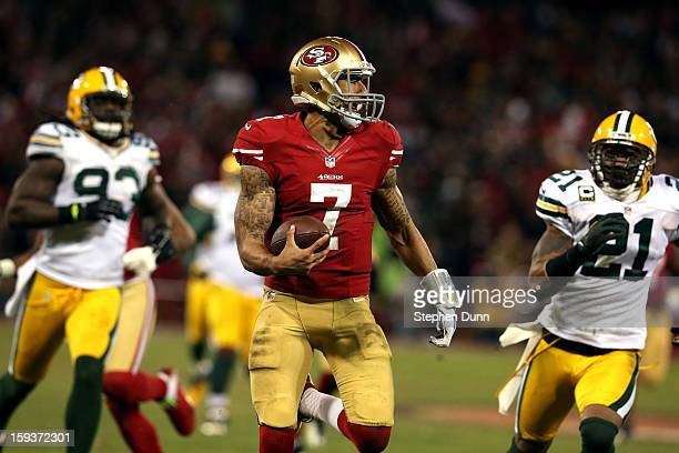 Quarterback Colin Kaepernick of the San Francisco 49ers runs the ball for a touchdown against the Green Bay Packers in the third quarter during the...