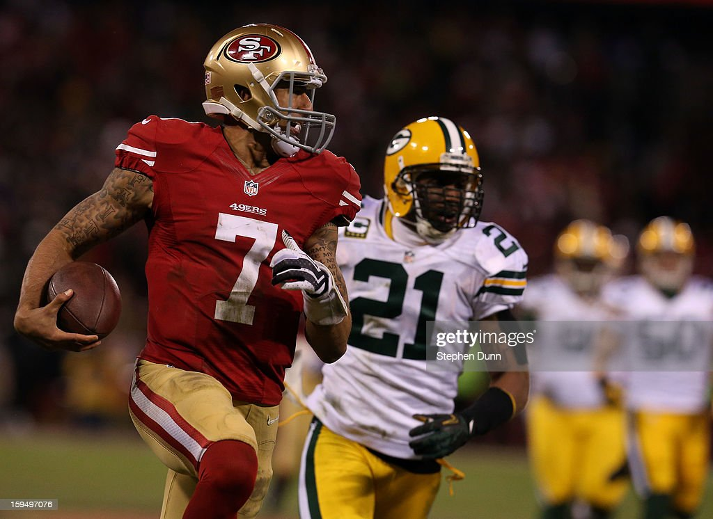 Quarterback Colin Kaepernick #7 of the San Francisco 49ers runs the ball against strong safety Charles Woodson #21 of the Green Bay Packers during the NFC Divisional Playoff Game at Candlestick Park on January 12, 2013 in San Francisco, California.