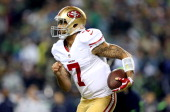 Quarterback Colin Kaepernick of the San Francisco 49ers runs the ball in the fourth quarter while taking on the Seattle Seahawks during the 2014 NFC...