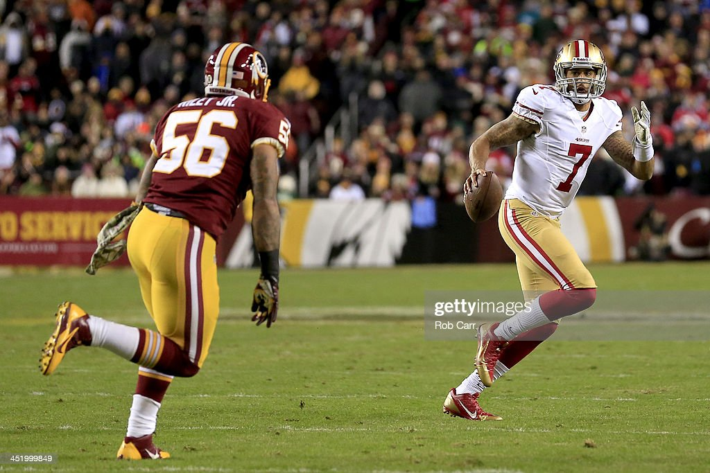 Quarterback Colin Kaepernick of the San Francisco 49ers runs with the ball against inside linebacker Perry Riley of the Washington Redskins in the...