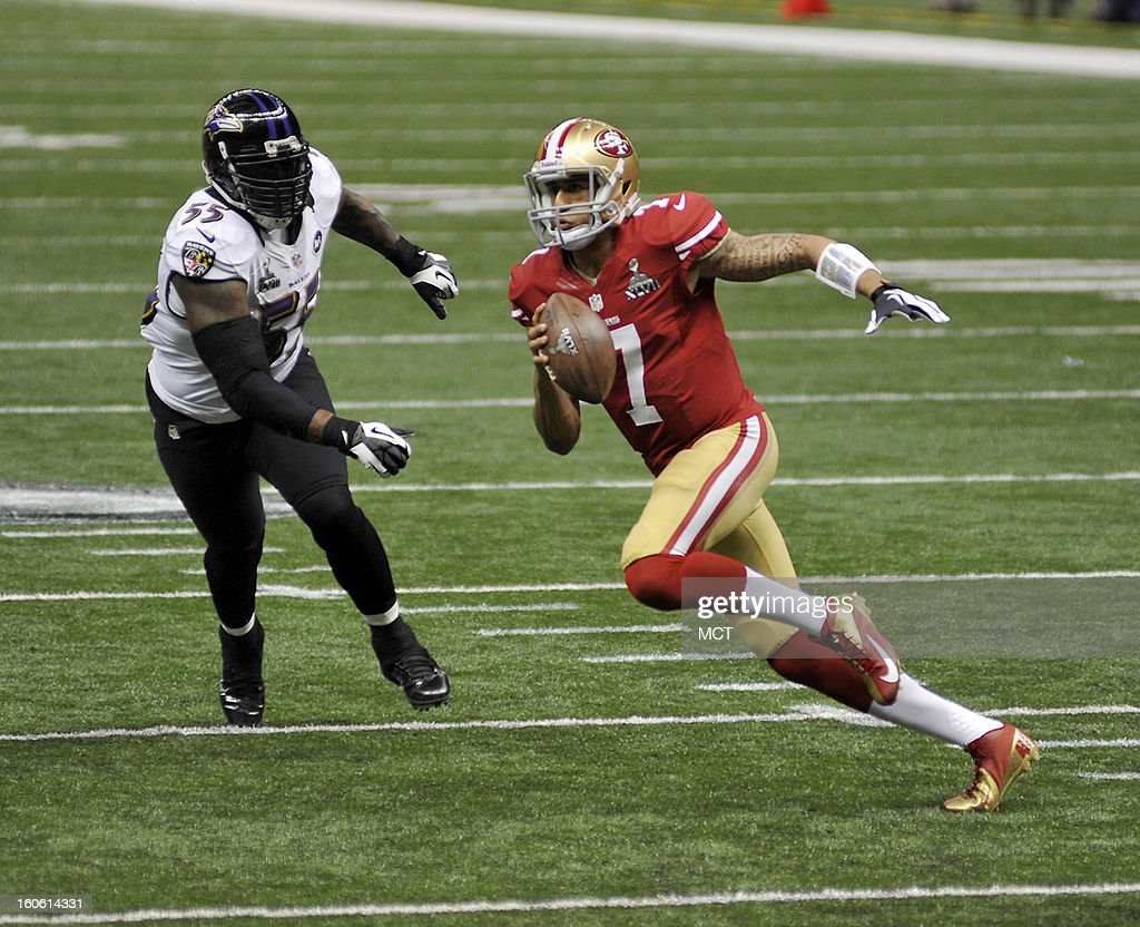 Quarterback Colin Kaepernick (7) of the San Francisco 49ers scrambles as Terrell Suggs (55) of the Baltimore Ravens gives chase in the first half of Super Bowl XLVII at the Mercedes-Benz Superdome in New Orleans, Louisiana, Sunday, February 3, 2013.