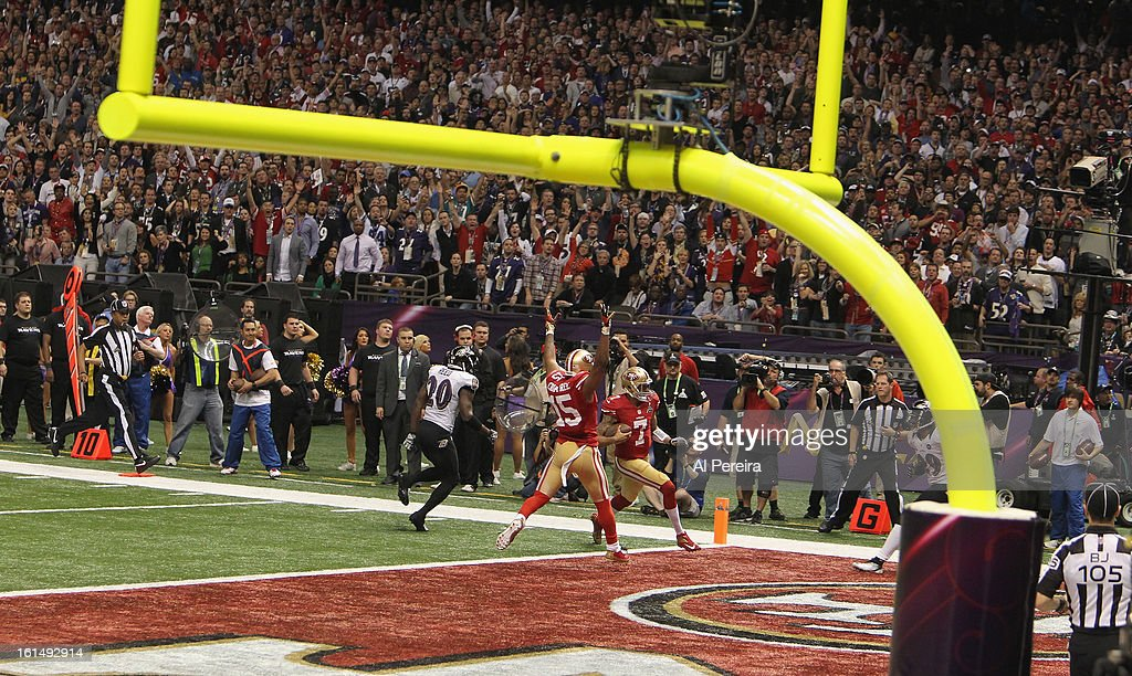 Quarterback Colin Kaepernick #7 of the San Francisco 49ers scrambles for a touchdown against the Baltimore Ravens during Super Bowl XLVII at Mercedes-Benz Superdome on February 3, 2013 in New Orleans, Louisiana.