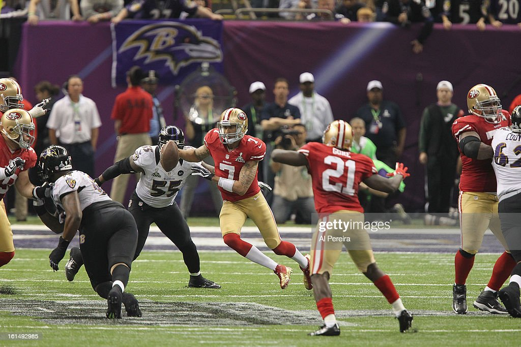 Quarterback Colin Kaepernick #7 of the San Francisco 49ers scrambles for a first down against the Baltimore Ravens during Super Bowl XLVII at Mercedes-Benz Superdome on February 3, 2013 in New Orleans, Louisiana.