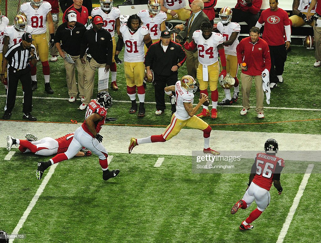 Quarterback Colin Kaepernick of the San Francisco 49ers scrambles against Sean Weatherspoon and Cliff Matthews of the Atlanta Falcons during the NFC...