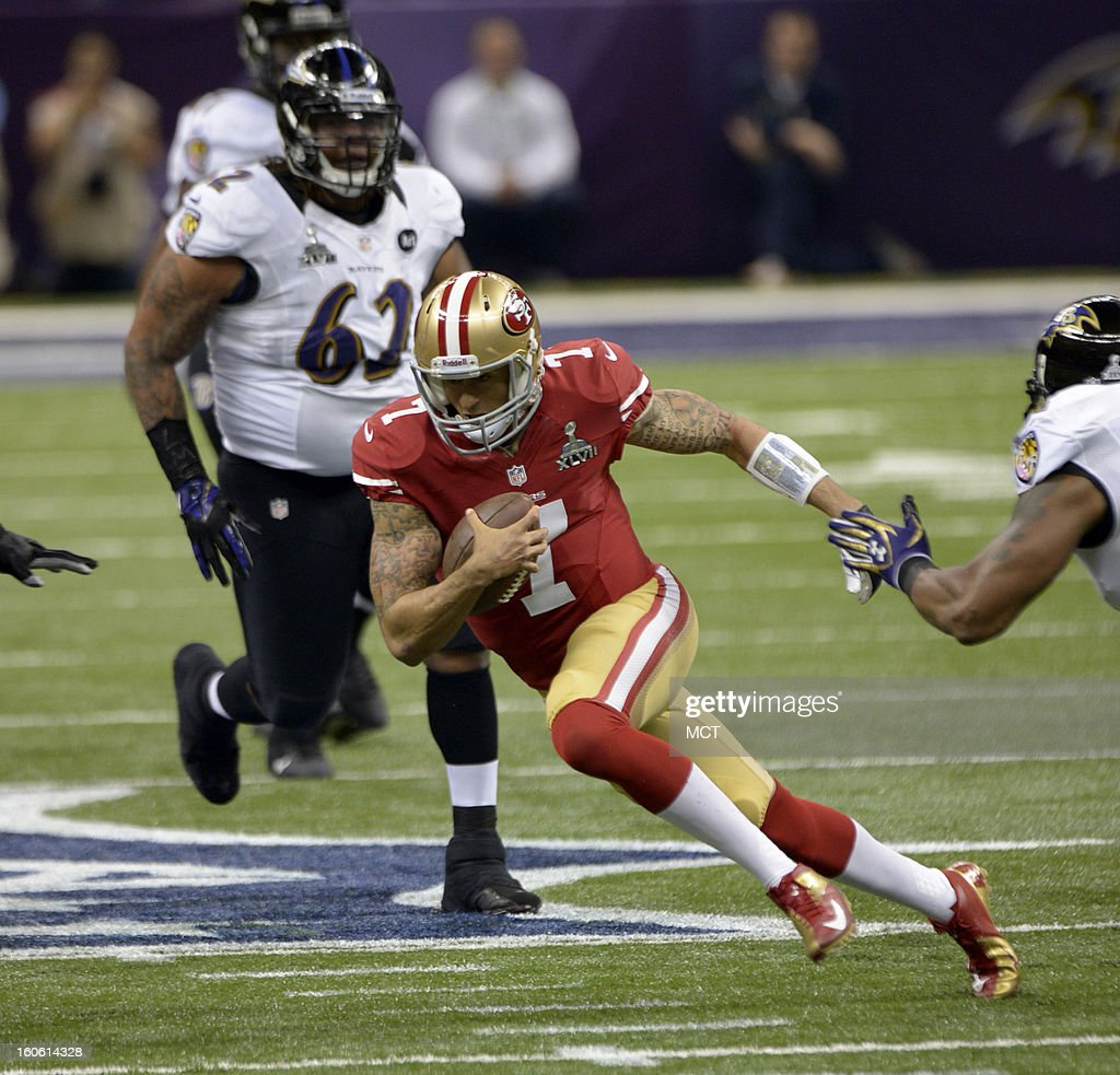 Quarterback Colin Kaepernick (7) of the San Francisco 49ers scrambles against the Baltimore Ravens in the first half of Super Bowl XLVII at the Mercedes-Benz Superdome in New Orleans, Louisiana, Sunday, February 3, 2013.