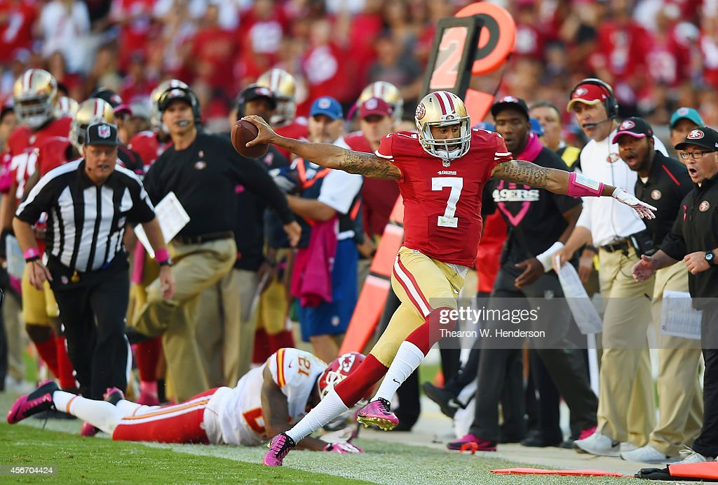 Quarterback Colin Kaepernick of the San Francisco 49ers scrambles nine yards for a first down against the Kansas City Chiefs during the fourth...