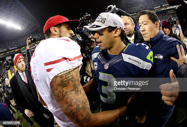 Quarterback Colin Kaepernick of the San Francisco 49ers shakes hands with quarterback Russell Wilson of the Seattle Seahawks after the Seahawks...