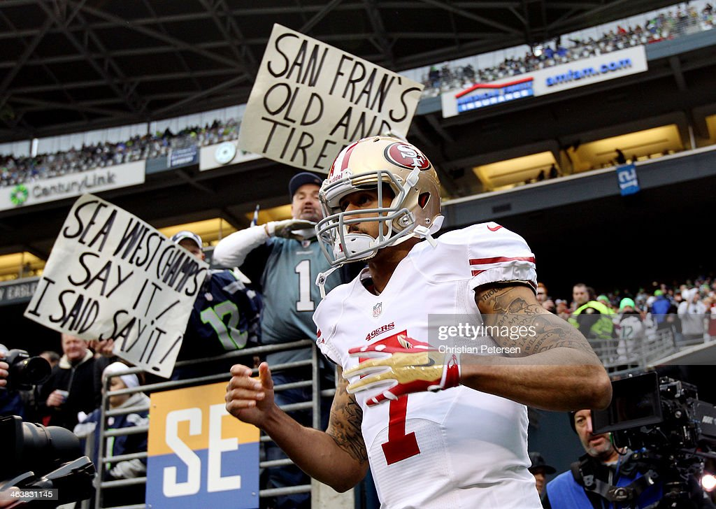 Quarterback Colin Kaepernick of the San Francisco 49ers takes the field prior to the 2014 NFC Championship against the Seattle Seahawks at...