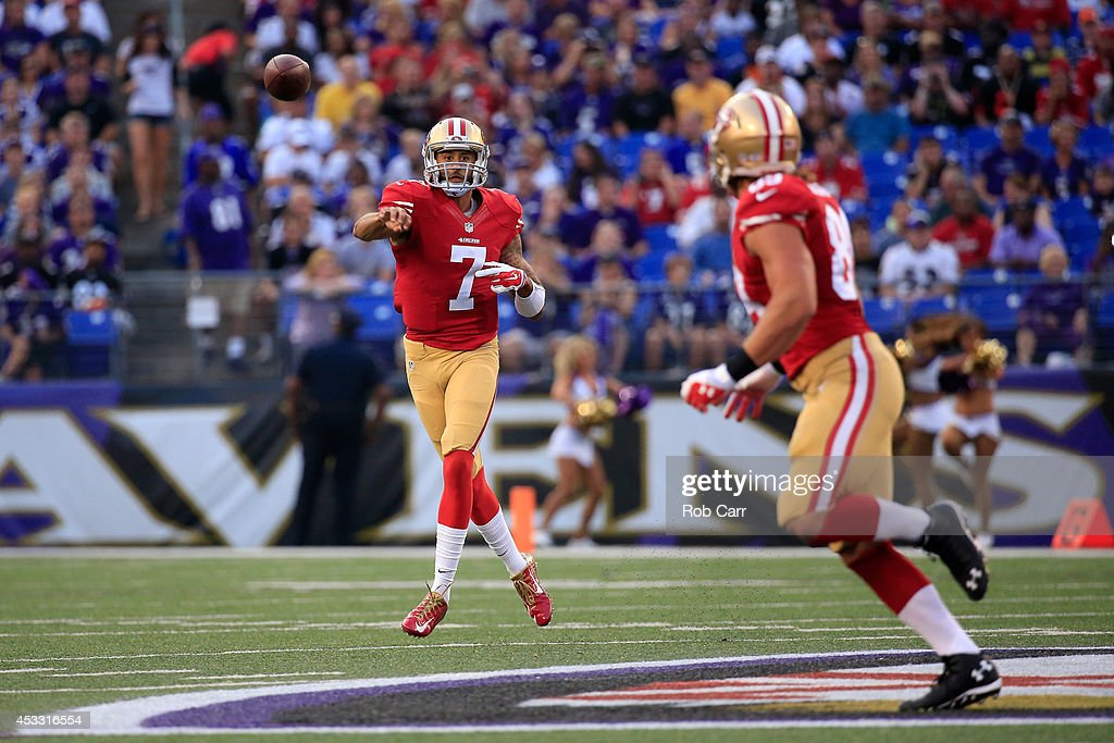 Quarterback Colin Kaepernick #7 of the San Francisco 49ers throws a pass to tight end Vance McDonald #89 against the Baltimore Ravens during the first half of an NFL pre-season game at M&T Bank Stadium on August 7, 2014 in Baltimore, Maryland.