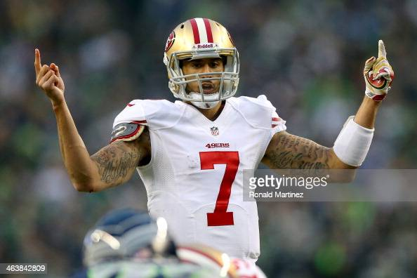Quarterback Colin Kaepernick of the San Francisco 49ers under center in the first half against the Seattle Seahawks during the 2014 NFC Championship...