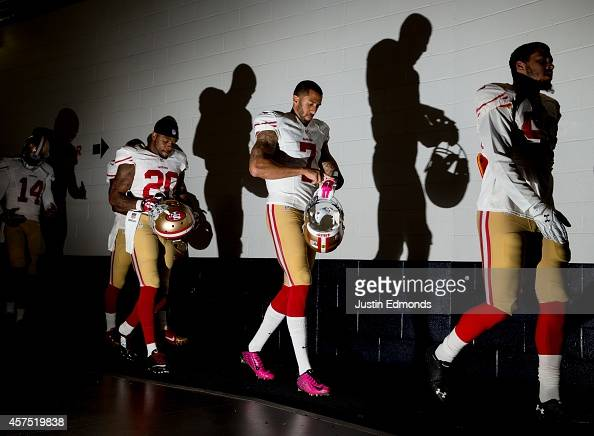 Quarterback Colin Kaepernick of the San Francisco 49ers walks in the tunnel with teammates as he prepares to face the Denver Broncos in a game at...