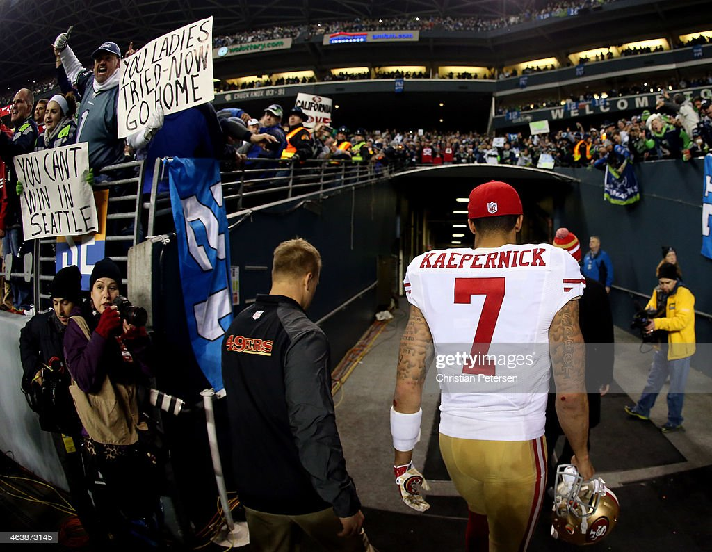 Quarterback <a gi-track='captionPersonalityLinkClicked' href=/galleries/search?phrase=Colin+Kaepernick&family=editorial&specificpeople=5525694 ng-click='$event.stopPropagation()'>Colin Kaepernick</a> #7 of the San Francisco 49ers walks off the field after losing to the Seattle Seahawks 23-17 in the 2014 NFC Championship at CenturyLink Field on January 19, 2014 in Seattle, Washington.