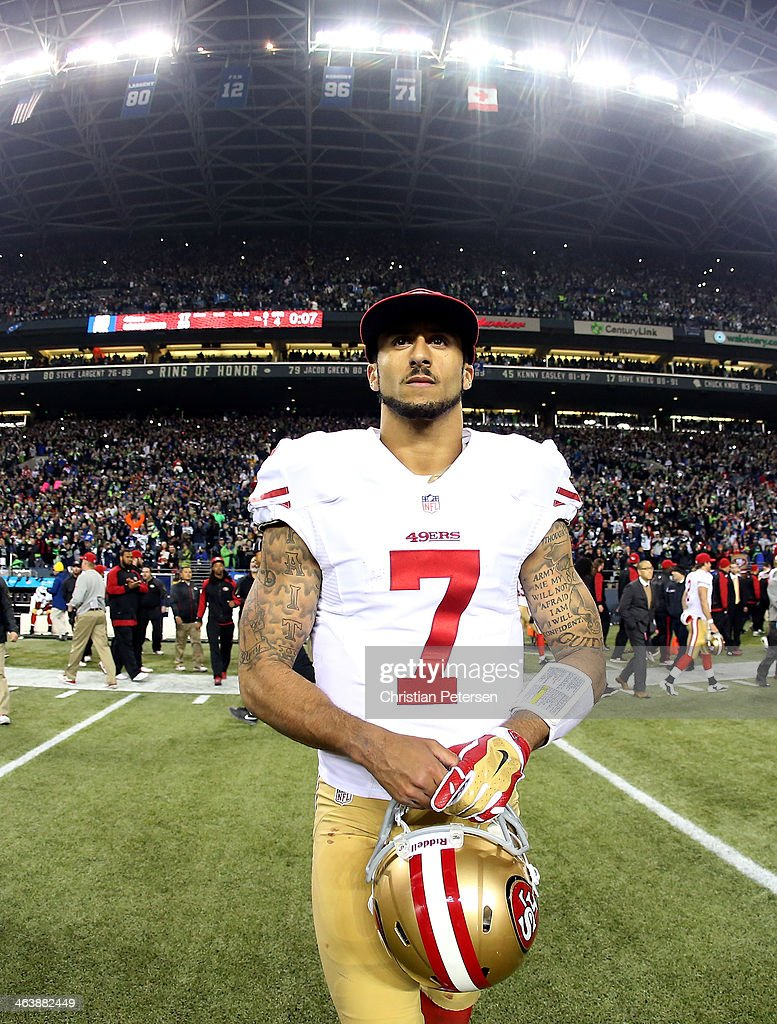Quarterback Colin Kaepernick #7 of the San Francisco 49ers walks off the field after losing to the Seattle Seahawks 23-17 during the 2014 NFC Championship at CenturyLink Field on January 19, 2014 in Seattle, Washington.