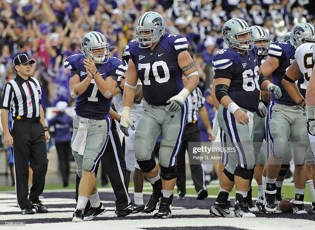 Quarterback Collin Klein #7 of the Kansas State Wildcats reacts after scoring a touchdown against the Missouri Tigers during a game on October 8, 2011 at Bill Snyder Family Stadium in Manhattan, Kansas. Kansas State defeated Missouri 24-17.
