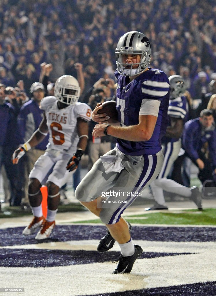 Quarterback <a gi-track='captionPersonalityLinkClicked' href=/galleries/search?phrase=Collin+Klein&family=editorial&specificpeople=5838707 ng-click='$event.stopPropagation()'>Collin Klein</a> #7 of the Kansas State Wildcats reacts after scoring a touchdown against the Texas Longhorns during the second half on December 1, 2012 at Bill Snyder Family Stadium in Manhattan, Kansas. Kansas State defeated Texas 42-24.