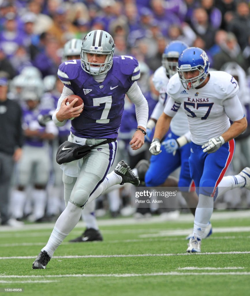 Quarterback <a gi-track='captionPersonalityLinkClicked' href=/galleries/search?phrase=Collin+Klein&family=editorial&specificpeople=5838707 ng-click='$event.stopPropagation()'>Collin Klein</a> #7 of the Kansas State Wildcats rushes 28 yards for a touchdown against the Kansas Jayhawks during the third quarter on October 6, 2012 at Bill Snyder Family Stadium in Manhattan, Kansas. Kansas State defeated Kansas 56-16.