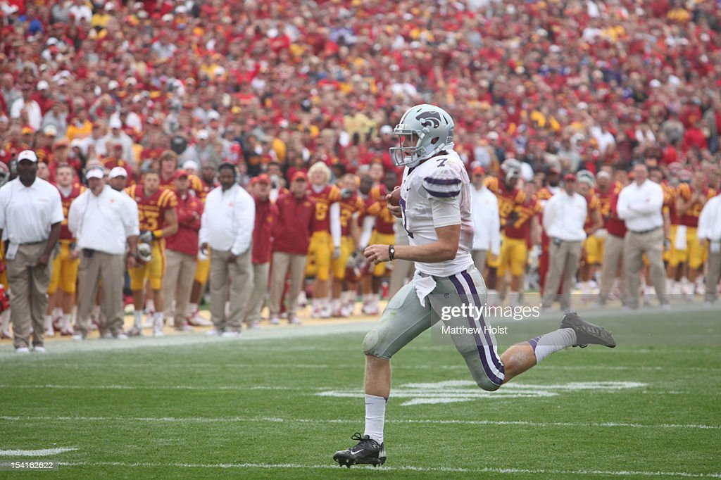 Quarterback <a gi-track='captionPersonalityLinkClicked' href=/galleries/search?phrase=Collin+Klein&family=editorial&specificpeople=5838707 ng-click='$event.stopPropagation()'>Collin Klein</a> #7 of the Kansas State Wildcats rushes down field in the third quarter on a touchdown run against the Iowa State Cyclones on October 13, 2012 at Jack Trice Stadium in Ames, Iowa. Kansas State defeated Iowa State 27-21.