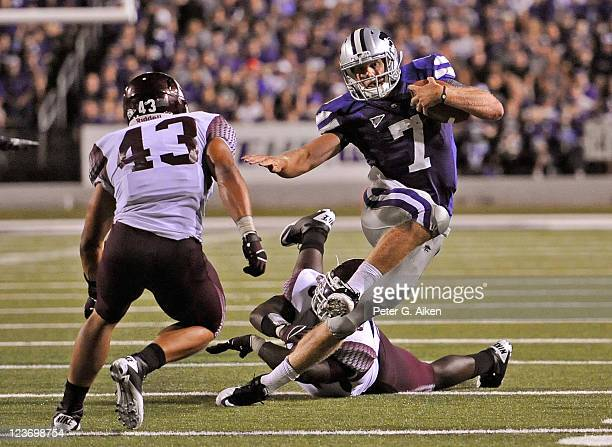 Quarterback Collin Klein of the Kansas State Wildcats rushes up field against pressure from linebacker Ichiro Vance of the Eastern Kentucky Colonels...