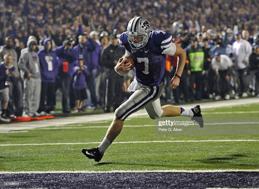 Quarterback <a gi-track='captionPersonalityLinkClicked' href=/galleries/search?phrase=Collin+Klein&family=editorial&specificpeople=5838707 ng-click='$event.stopPropagation()'>Collin Klein</a> #7 of the Kansas State Wildcats scores a touchdown against the Texas Longhorns during the second half on December 1, 2012 at Bill Snyder Family Stadium in Manhattan, Kansas. Kansas State defeated Texas 42-24.