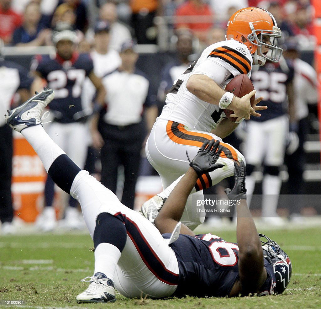Quarterback <a gi-track='captionPersonalityLinkClicked' href=/galleries/search?phrase=Colt+McCoy&family=editorial&specificpeople=2701586 ng-click='$event.stopPropagation()'>Colt McCoy</a> #12 of the Cleveland Browns breaks the tackle of defensive end Tim Jamison #96 of the Houston Texans on November 6, 2011 at Reliant Stadium in Houston, Texas.