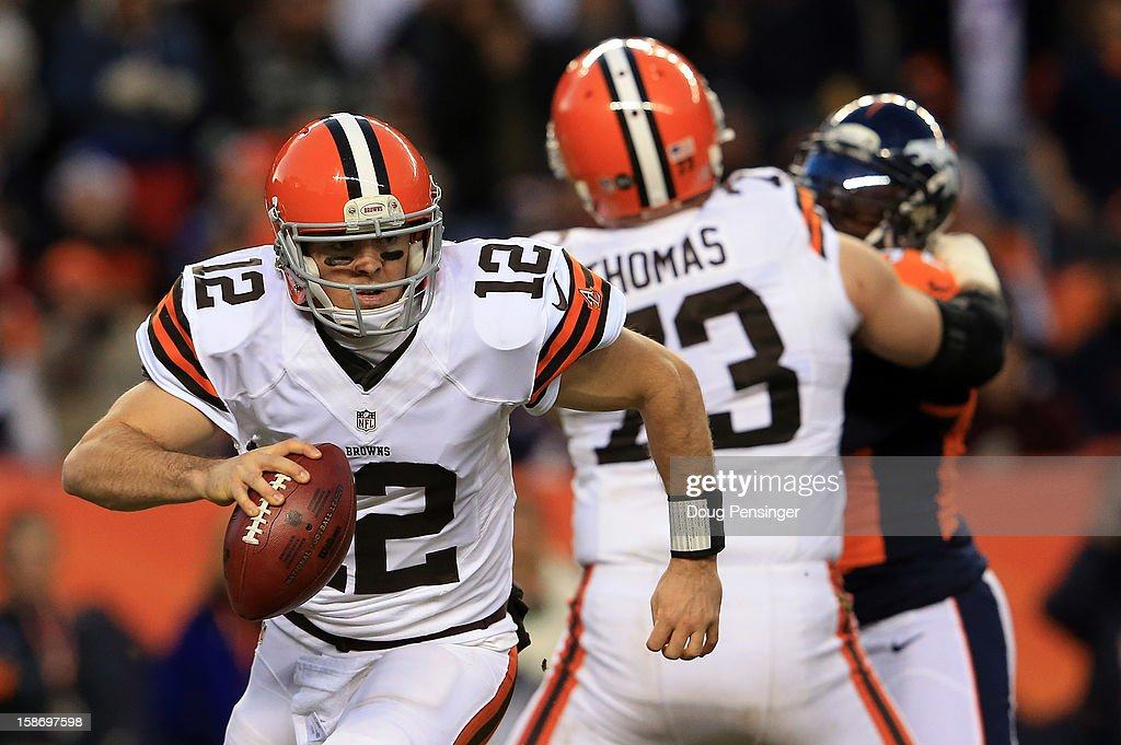 Quarterback <a gi-track='captionPersonalityLinkClicked' href=/galleries/search?phrase=Colt+McCoy&family=editorial&specificpeople=2701586 ng-click='$event.stopPropagation()'>Colt McCoy</a> #12 of the Cleveland Browns rolls out and looks for a receiver under protection from tackle Joe Thomas #73 of the Cleveland Browns against the Denver Broncos at Sports Authority Field at Mile High on December 23, 2012 in Denver, Colorado. The Broncos defeated the Browns 34-12.