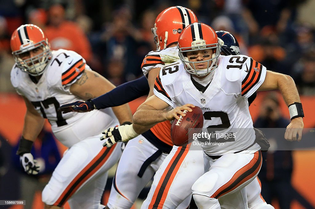 Quarterback <a gi-track='captionPersonalityLinkClicked' href=/galleries/search?phrase=Colt+McCoy&family=editorial&specificpeople=2701586 ng-click='$event.stopPropagation()'>Colt McCoy</a> #12 of the Cleveland Browns rolls out and looks for a receiver against the Denver Broncos at Sports Authority Field at Mile High on December 23, 2012 in Denver, Colorado. The Broncos defeated the Browns 34-12.