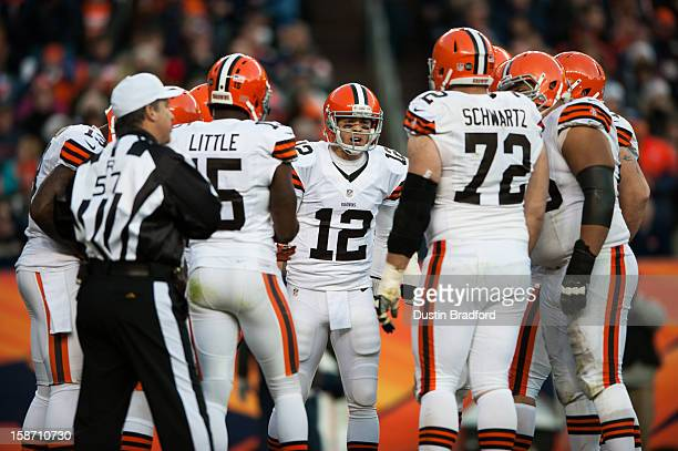 Quarterback Colt McCoy of the Cleveland Browns takes over the offense after an injury to quarterback Brandon Weeden during a game against the Denver...