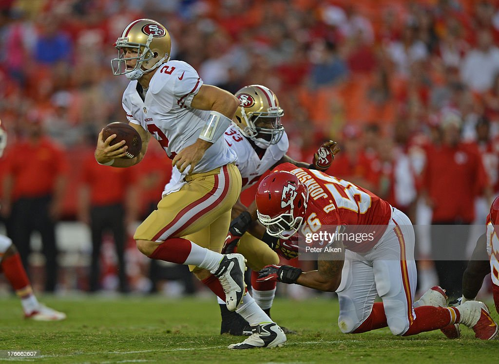 Quarterback <a gi-track='captionPersonalityLinkClicked' href=/galleries/search?phrase=Colt+McCoy&family=editorial&specificpeople=2701586 ng-click='$event.stopPropagation()'>Colt McCoy</a> #2 of the San Francisco 49ers rushes for a first down against the Kansas City Chiefs during the first half on August 16, 2013 at Arrowhead Stadium in Kansas City, Missouri.