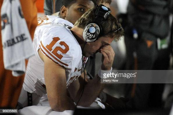 Quarterback Colt McCoy of the Texas Longhorns sits on the bench during the Citi BCS National Championship game against the Alabama Crimson Tide at...