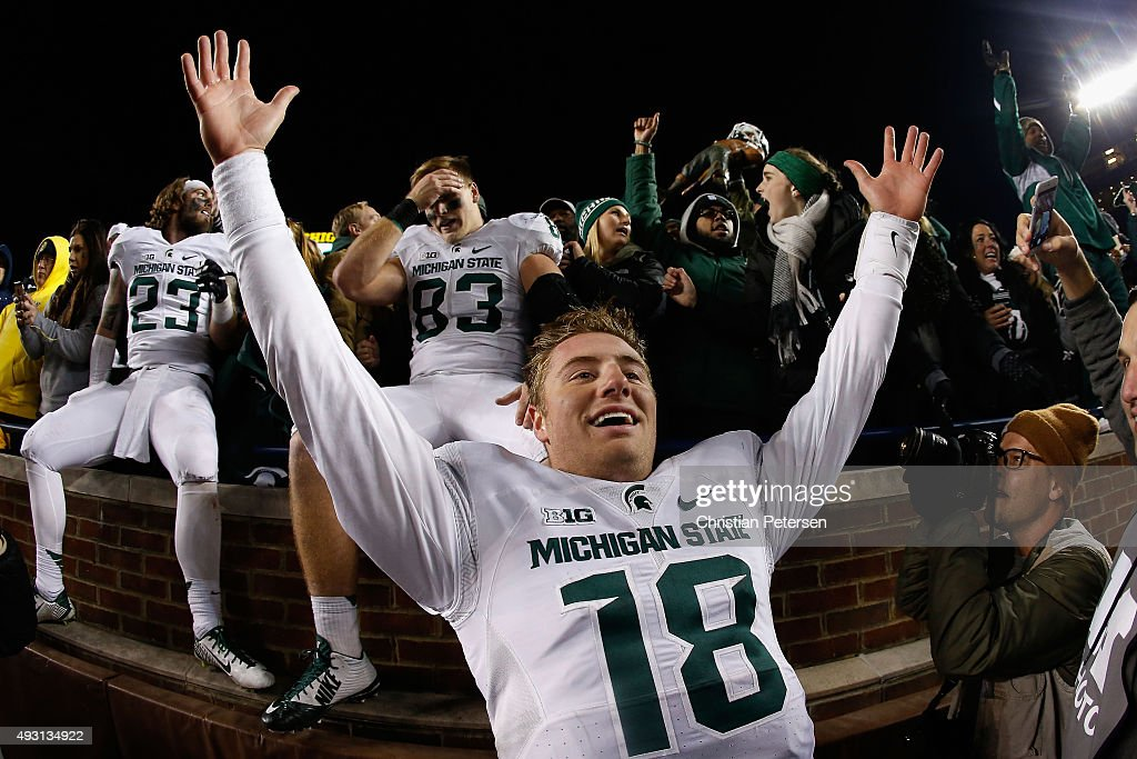 Quarterback Connor Cook of the Michigan State Spartans celebrates after defeating the Michigan Wolverines 2723 in the college football game at...